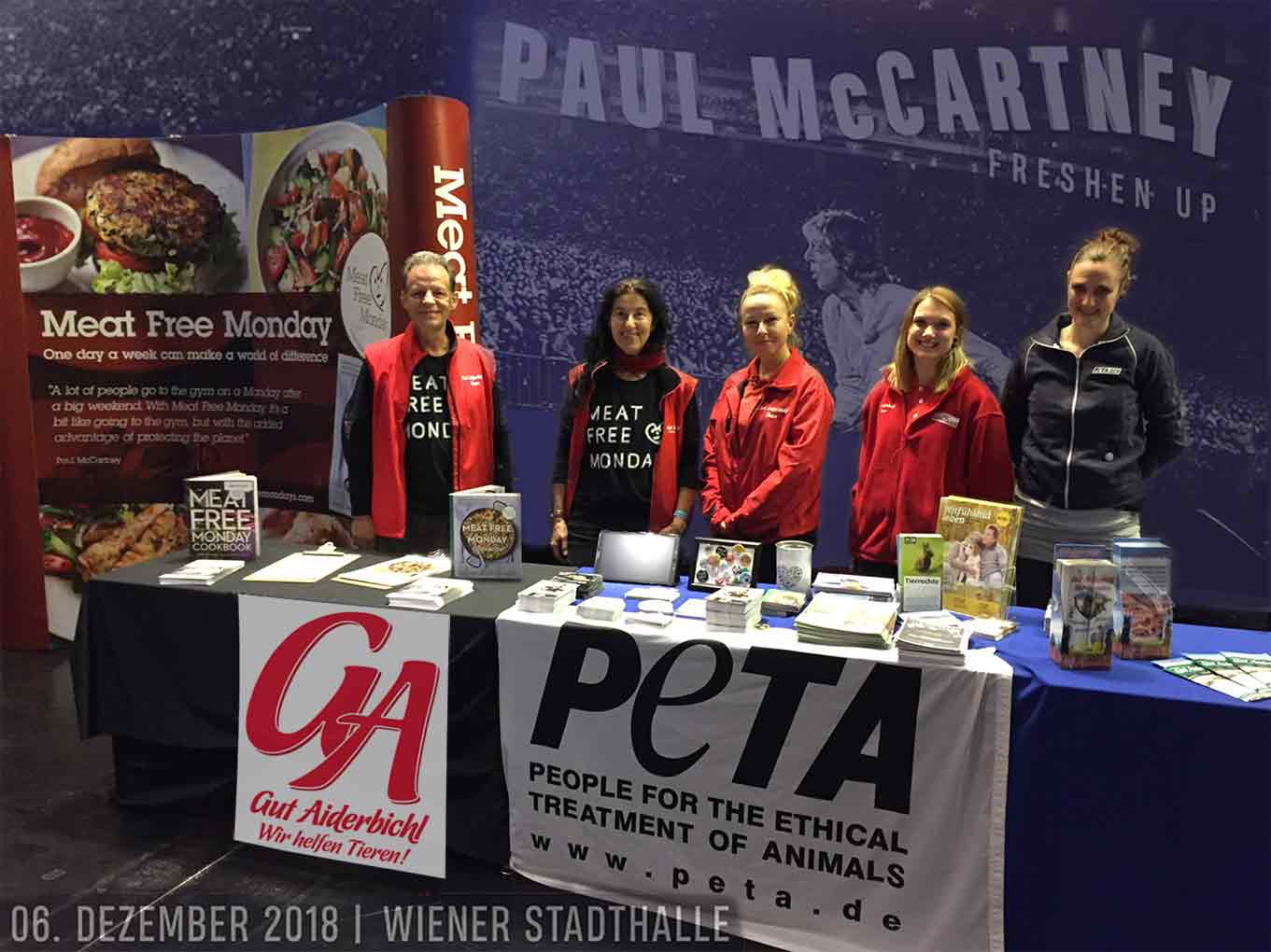 Ursula DEMARMELS, Univ.-Prof. Dr. Gerhard W. HACKER and representatives of Gut Aiderbichl and PETA running the MeatFreeMondays-stand at Paul McCartney's concerts of the Wiener Stadthaltte. Dec.6, 2018. (c): Dr. Gerhard W. Hacker, Salzburg. Used by agreement with Barracuda Music, Vienna, Gut Aiderbichl, PETA Germany & www.meatfreemondays.com